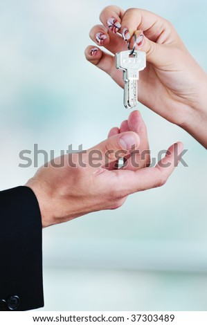 man and woman hand closeup with home keys representing buying and selling new apartment and real estate concept - stock photo