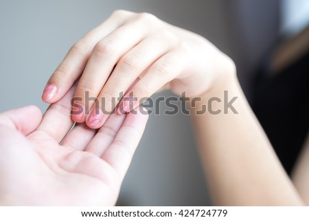 Man and woman hand holding. concept of love.