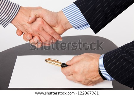 Man and woman hand shaking - stock photo
