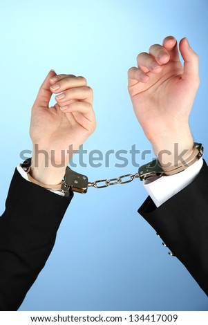 Man and woman hands and breaking handcuffs on color background