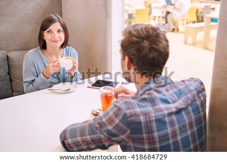 Man and woman having a drink together