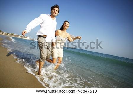 Man and woman having fun on the beach - stock photo