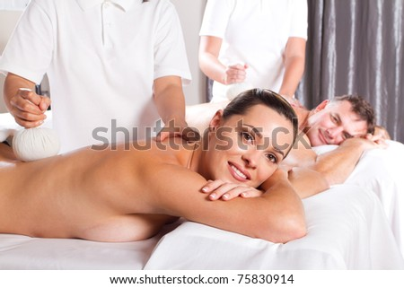 man and woman having Thai massage - stock photo