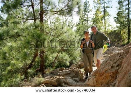 Man and woman hiking - stock photo