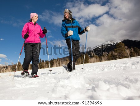 Man and Woman Hiking in Snowshoes - stock photo