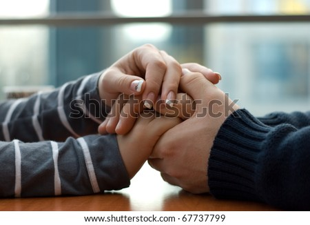 Man and woman holding each other hands - stock photo
