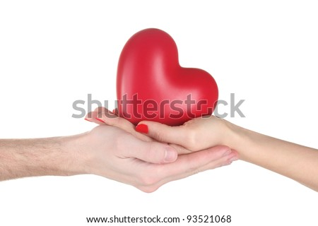 Man and woman holding red heart in hands isolated on white