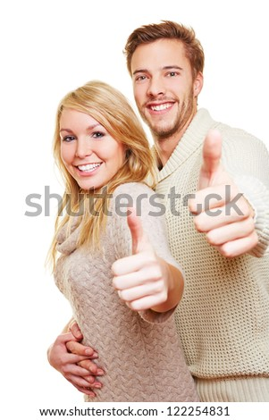 Man and woman holding together their thumbs up and smiling - stock photo