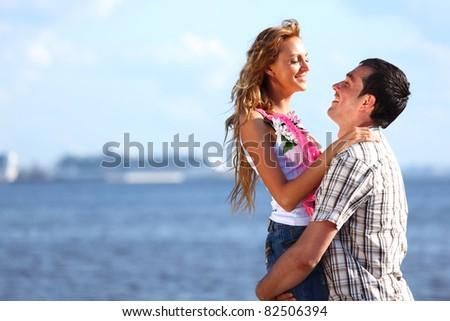 man and woman hug in the sky - stock photo