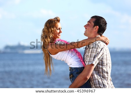 man and woman hug in the sky and sea on sea