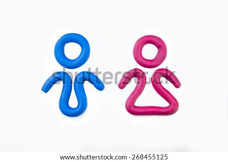 man and woman icon made out of play dough - stock photo