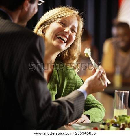 Man and Woman in a Bar - stock photo