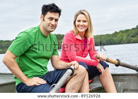 Man and woman in a boat on a lake