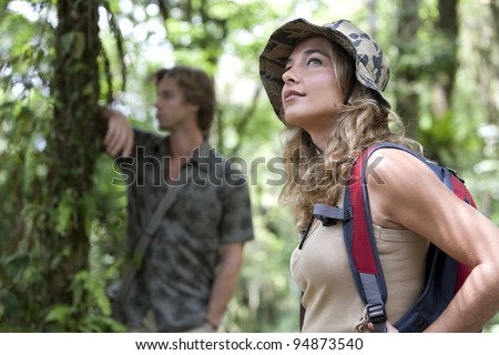 Man and woman in a forest expedition. - stock photo