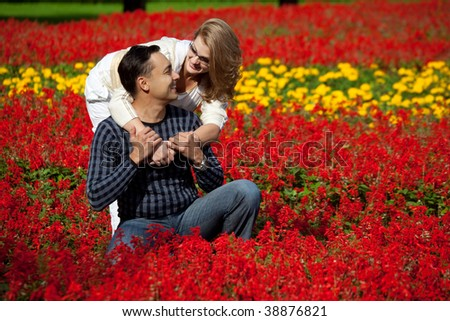 man and woman in braces laughing in the flowers