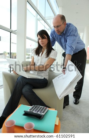 Man and woman in business training - stock photo