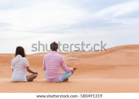 Man And Woman In Desert Sitting Lotus Pose Young Couple Meditating Sand Dune Background