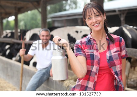 man and woman in farm - stock photo