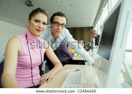 Man and woman in front of a laptop computer - stock photo
