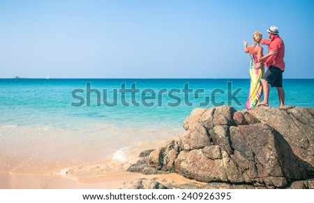 man and woman in love by the sea ocean  loving couple on the beach - stock photo