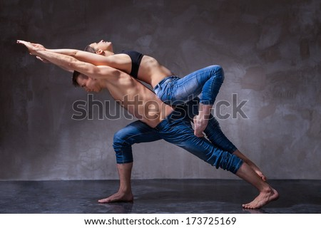 Man and woman in passionate dance pose - stock photo