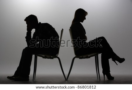 Man and woman in silhouette - stock photo