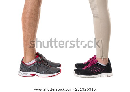 Man and woman in sneakers opposite each other - stock photo