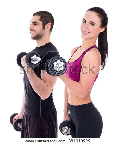man and woman in sportswear doing exercises with dumbbells isolated on white background - stock photo