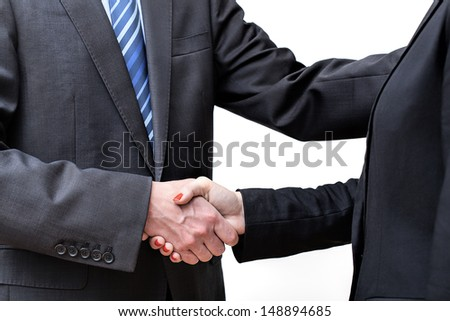 Man and woman in suits exchanging greetings