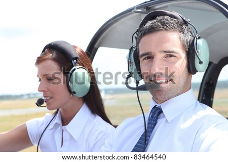 Man and woman in the cockpit of a light aircraft - stock photo