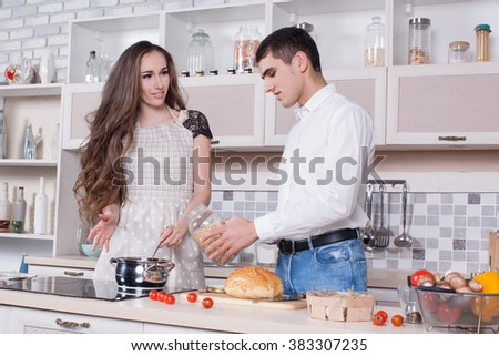 Man and woman in the kitchen fun and happy couple.People are ready food in the kitchen