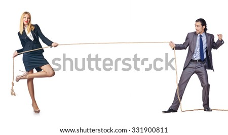 Man and woman in tug of war concept - stock photo