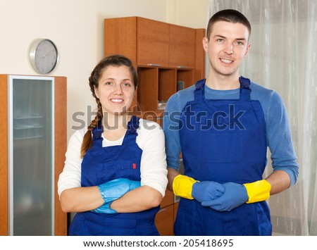 Man and woman in uniform is ready to work - stock photo