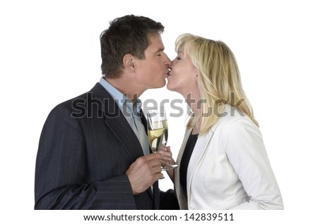 Man and woman kissing and celebrating with Champagne, Studio Shot