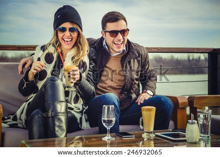 Man and woman laughing - stock photo