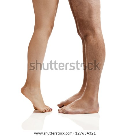 Man and woman legs isolated on a white background - stock photo