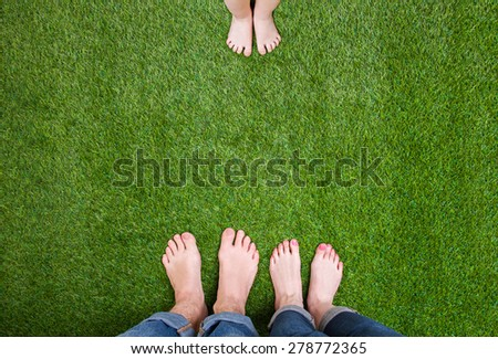 Man and woman legs standing close opposite child