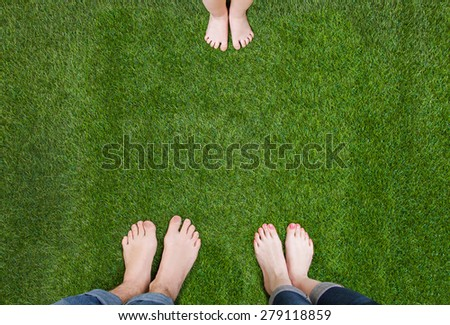 Man and woman legs standing opposite child ones