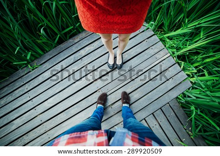 Man and woman legs top on the desk board - stock photo