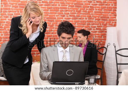 Man and woman looking at a laptop computer - stock photo