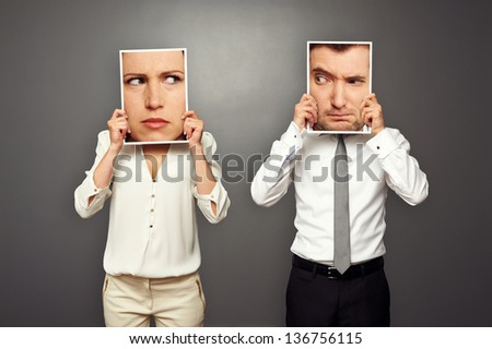 man and woman looking suspiciously at each other. concept photo - stock photo