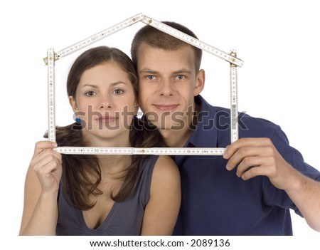 man and woman looking throw home shape measure - stock photo