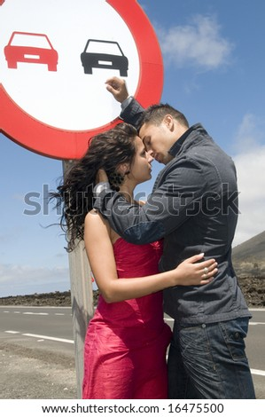 man and woman loving on the road
