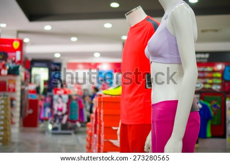 Man and woman mannequin in sport bra and trousers - stock photo