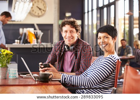 Man and woman meeting at a coffee shop