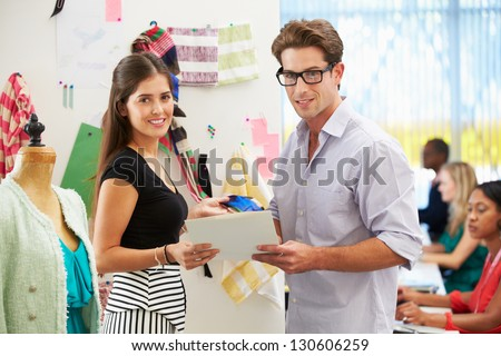 Man And Woman Meeting In Fashion Design Studio - stock photo