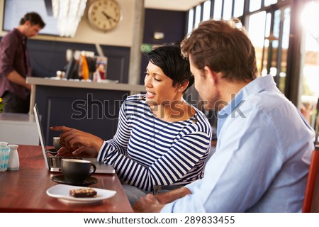 Man and woman meeting over coffee in a restaurant - stock photo