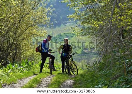 Man and woman on bike - stock photo