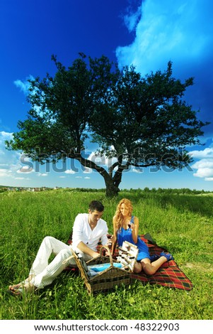 man and woman on picnic
