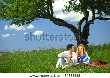man and woman on picnic - stock photo